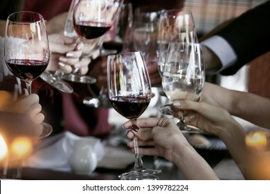 Glasses of  wine  during a friendly party of a celebration. of out focus