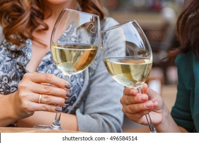 Glasses of wine in the hands of women