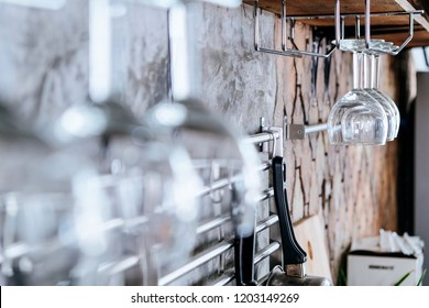 Glasses of wine hanging above a bar rack