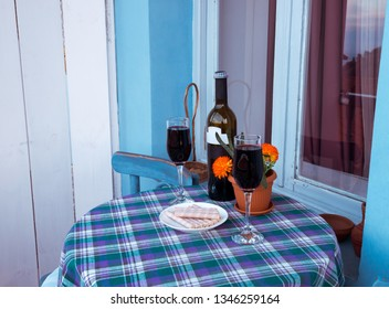 Glasses of wine on the balcony