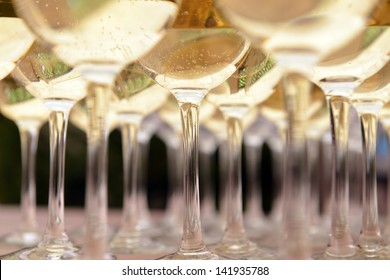 Glasses with wine on table - party background
