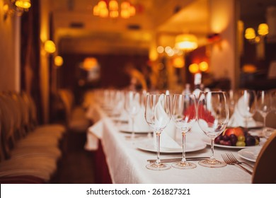glasses of wine on a table in a restaurant