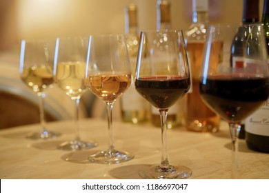 Glasses of wine set on table in winery for tasting