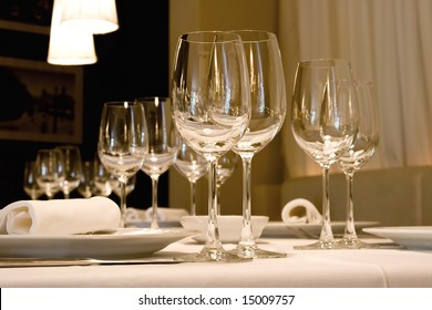 Glasses of wine set at restaurant table.