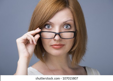 Glasses woman showing eyewear happy holding glasses frame. Closeup of young caucasian woman