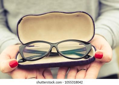 glasses in women's hands