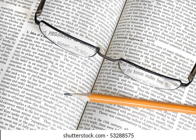 glasses,pencil  with book