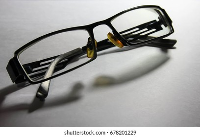glasses/Spectacles/Glasses black and white close up. White background.