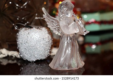 Glassy statuette of angel and apple decoration at Christmas time and New Year's Eve