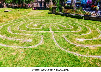 GLASTONBURY, ENGLAND - JUNE 30, 2015: Glastonbury Tercentennial labyrinth with unidentified people. It was built to celebrate Glastonbury receiving its town charter from Queen Anne in 1705