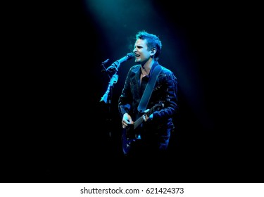 Glastonbury Festival - June 24 2016: Matt Belamy with British  band Muse performing on the Pyramid Stage Glastonbury Festival, Pilton, Somerset June 24, 2016 in Somerset, UK