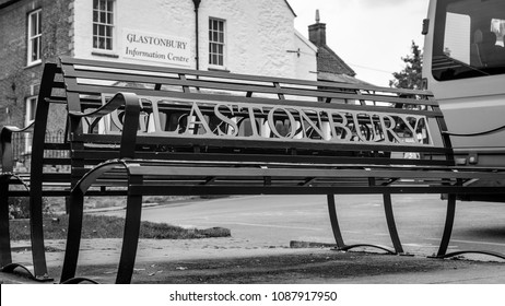 Glastonbury Iron Bench, Ironwork outside Glastonbury Information Centre, England 2018 black and white tone shallow depth of field