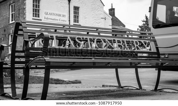 Glastonbury Iron Bench, Ironwork outside Glastonbury Information Centre, England 2018 black and white tone shallow depth of field