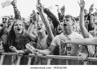 Glastonbury, Somerset, UK - June 26th 2015: Festival goers enjoying The Courteeners performing on the Other Stage at Glastonbury Festival 2015.
