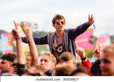 Glastonbury, Somerset, UK - June 26th 2015: Festival goer enjoying The Courteeners performing on the Other Stage at Glastonbury Festival 2015.
