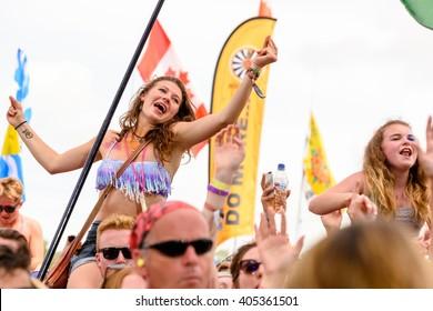 Glastonbury, Somerset, UK - June 27, 2015 - Festival goer enjoying George Ezra playing Glastonbury Festival's Pyramid Stage