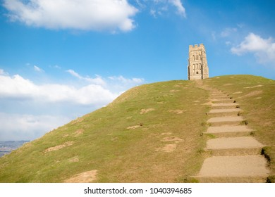 Glastonbury Tor in Somerset, United Kingdom, with the ruins of St Michael's Church demolished in 1539 during the Dissolution of the Monasteries