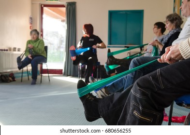Glastonbury, UK - 2014, 07 January: Occupational therapy instructor provides training exercises for multiple sclerosis  patients at health center..