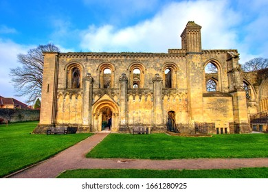 Glastonbury, UK - December 30, 2019: View of the Lady Chapel, the best preserved part of Glastonbury Abbey ruins, in a warm winter afternoon