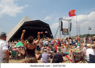 GLASTONBURY,UK - JUNE 27: A festival crowd of music fans gather by the Pyramid Stage at  Glastonbury Festival on 27th June, 2010 at Pilton Farm, Somerset.
