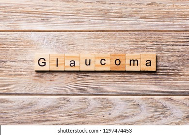 GLAUCOMA word written on wood block. GLAUCOMA text on wooden table for your desing, concept.