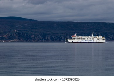 Glavotok Croatia Aprl  7 2019:View from the Monastery in Glavotok port as passenger ferry passing by , Krk Island.