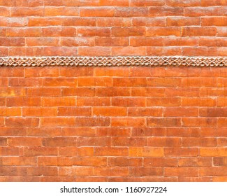 Glazed brick wall texture with a frieze in the top third