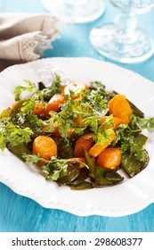 Glazed carrots with pea pods