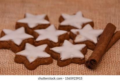 glazed cookies and dried cinnamon sticks