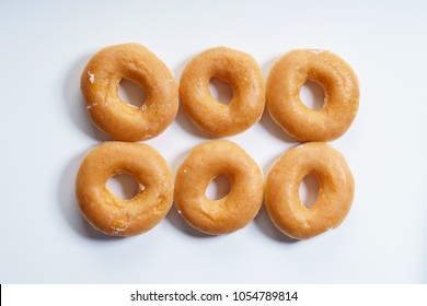 glazed donuts on white background, top view.