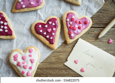Glazed heart shaped cookies for Valentine's day with text Love you - delicious homemade natural organic pastry, baking with love for Valentine's day