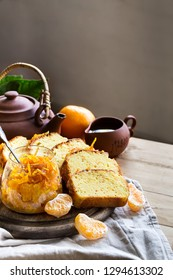 Glazed orange cake with tangerine jam topping and tea with lemon