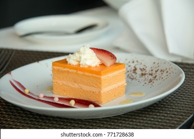 Glazed  Orange Sponge Cake on a white plate