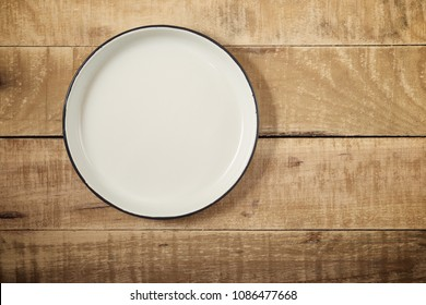 Glazed plate on a wooden table.