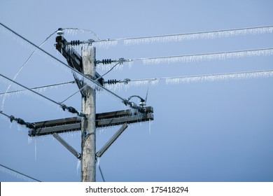 Glazed Power Line Utility Pole Electric Line from Winter Ice Snow Storm, Icicles