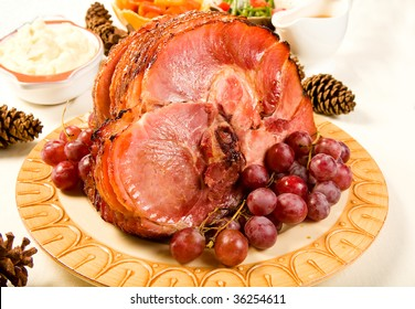 Glazed Spiral Sliced Ham garnished with red globe grapes