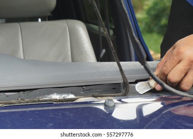 Glazier using tools repairing to fix crack broken windshield on the front window glass of the machine car accident.Suction , Vacuum, Suction - Pads, Grippers, Cup Mountings.