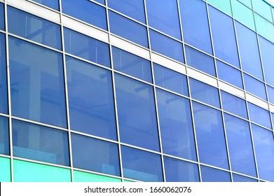 glazing of the building. glass plane background. blue glazing on the facade of the building