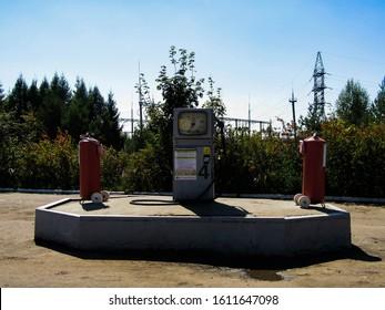 Glazunovka, Russia - August 20, 2019. Old design petrol pump in a gas station.