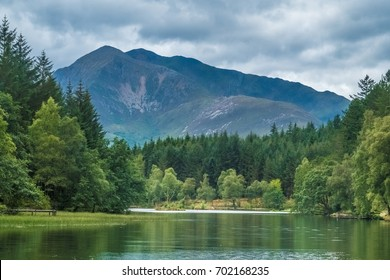 Glen Coe (Gleann Comhann), a narrow spectacular glen of volcanic origin in the Highlands of Scotland, surrounded by wild and precipitous mountains and traversed by the river Coe.