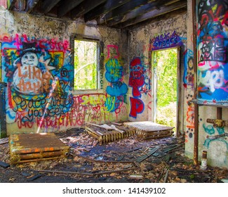 GLEN COVE, NY - MAY 10: Graffiti covered abandoned building on grounds of Pratt Mansion, Glen Cove NY on May 10, 2013. Former home of Harold Pratt the estate was once a Long Island Gold Coast Mansion