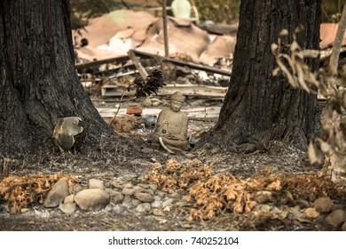 GLEN ELLEN, CALIFORNIA/ USA - OCT 16, 2017: Lawn ornaments near the remains of a home in a Sonoma County Neighborhood. Fires in California have burned over 220,000 acres and destroyed 5700 structures.
