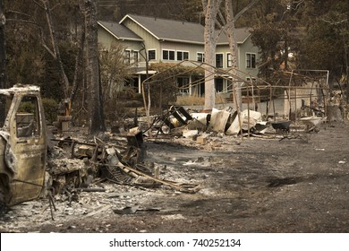 GLEN ELLEN, CALIFORNIA/ USA - OCT 16, 2017: A burned home next to an intact one in a Sonoma County Neighborhood. Fires in California have burned over 220,000 acres and destroyed 5700 structures.