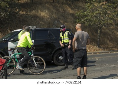 GLEN ELLEN, CALIFORNIA/ USA - OCT 16, 2017: Residents of Glen Ellen speak to a CHP officer at a road block. Fires in California have burned over 220,000 acres and destroyed 5700 structures.