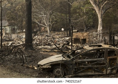 GLEN ELLEN, CALIFORNIA/ USA - OCT 16, 2017: A burned car near the remains of a home in a Sonoma County Neighborhood. Fires in California have burned over 220,000 acres and destroyed 5700 structures.