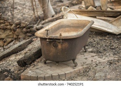 GLEN ELLEN, CALIFORNIA/ USA - OCT 16, 2017: A bathtub sits in the burned remains of a Sonoma County home. Fires in California have burned over 220,000 acres and destroyed 5700 structures.