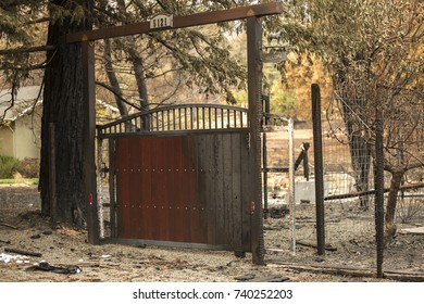 GLEN ELLEN, CALIFORNIA/ USA - OCT 16, 2017: A partially charred gate in a badly burnt Sonoma County neighborhood. Fires in California have burned over 220,000 acres and destroyed 5700 structures.