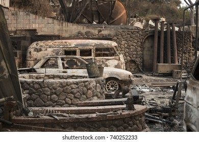 GLEN ELLEN, CALIFORNIA/ USA - OCT 16, 2017: Burned cars by the remains of a home in a Sonoma County Neighborhood. Fires in California have burned over 220,000 acres and destroyed 5700 structures.