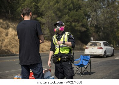 GLEN ELLEN, CALIFORNIA/ USA - OCT 14, 2017: A resident of Glen Ellen speaks to a CHP officer at a road block. Fires in California have burned an estimated 220,000 acres and destroyed 5700 structures.