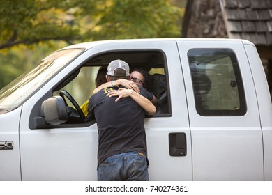 GLEN ELLEN, CALIFORNIA/ USA - OCT 14, 2017: Friends reunite at a CHP road block. The man has lost his home. Fires in northern California have burned over 220,000 acres and destroyed 5700 structures.